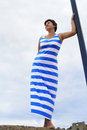 Woman in greek flag dress beautiful adult brunette wearing color against cloudy sky greece Stock Image