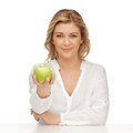 Woman with green apple picture of in casual clothes Stock Images