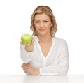 Woman with green apple picture of in casual clothes Royalty Free Stock Photo