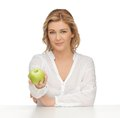 Woman with green apple picture of in casual clothes Royalty Free Stock Images