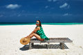 Woman in green dress on a beach at Maldives Stock Photos