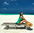 Woman in green dress on a beach at maldives tropical Stock Photos