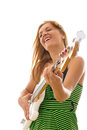Woman in green dress playing electric bass guitar smiling with energy Royalty Free Stock Photography
