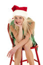 Woman green dress santa hat small smile Royalty Free Stock Photography