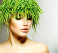 Woman with green grass hair beauty spring fresh Royalty Free Stock Image
