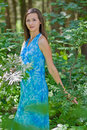 Woman among green leaves in the forest Royalty Free Stock Images