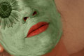 Woman with green mask on face a treatment her Royalty Free Stock Images
