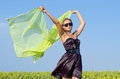 Woman with green scarf blowing in wind Stock Photography