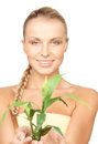Woman with green sprout closeup picture of Royalty Free Stock Photography