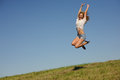 Woman on the green summer field young jumping Royalty Free Stock Photography