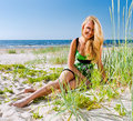 Woman in green sundress happy on a beach Royalty Free Stock Photo