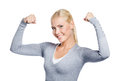 Woman grey sweater showing her strong muscles isolated white Royalty Free Stock Photos