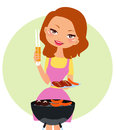 A woman grilling hot dogs Royalty Free Stock Images