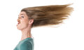 Woman with grimace cuts hair in the wind isolated on white Stock Photos