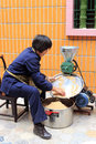 Woman grinding peanut in chinese new year amoy city china Stock Photos