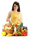 Woman with groceries in wicker basket on white Stock Photos