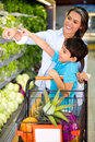 Woman grocery shopping with her kid Royalty Free Stock Photography