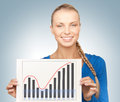 Woman with growth graph on board bright picture of confident Stock Photos