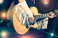 Woman guitarist in the country band Stock Image