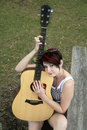 Woman guitarist in the park Stock Photography