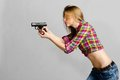 Woman with gun Stock Photography