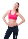 Woman in gym clothes smiling portrait of a cute young on isolated white background Stock Images