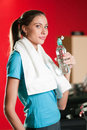 Woman at the gym drinking water Stock Photos