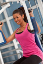 Woman at the gym exercising Royalty Free Stock Image