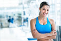 Woman at the gym happy with arms crossed Stock Photography
