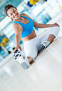 Woman at the gym stretching her leg before workout Royalty Free Stock Photography