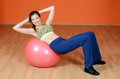 The woman with a gymnastic ball Stock Images