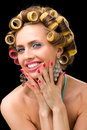 Woman with hair curlers Royalty Free Stock Images