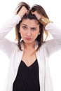 Woman with hair standing on end young Stock Photo