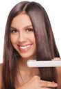 Woman with hair straightening irons Stock Photos