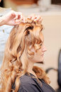 Woman hair styling side view of getting styled with curls at a salon Stock Photography