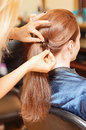 Woman hair styling a young having her long styled at a salon Stock Photography