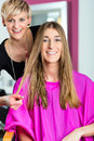 Woman at the hairdresser getting advise on her hair styling Royalty Free Stock Photo