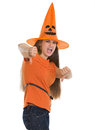 Woman in Halloween hat showing thumbs down Stock Photos
