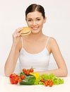 Woman with hamburger and vegetables picture of beautiful Stock Photography