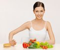 Woman with hamburger and vegetables picture of beautiful Royalty Free Stock Images