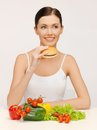 Woman with hamburger and vegetables picture of beautiful Royalty Free Stock Image