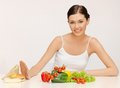 Woman with hamburger and vegetables picture of beautiful Stock Photos