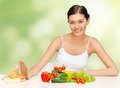 Woman with hamburger and vegetables picture of beautiful Royalty Free Stock Photos