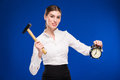 Woman with hammer and alarm clock Royalty Free Stock Photo