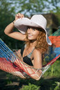 Woman in hammock Stock Photo