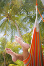 Woman in a Hammock Stock Image