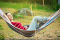 Woman in hammock young resting Stock Photography