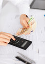 Woman hand with calculator and euro money business office household school tax education concept Royalty Free Stock Photo