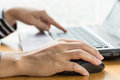 Woman hand click mouse and laptop Royalty Free Stock Photo