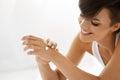 Woman Hand Cream. Close Up Of Beautiful Girl Applying Lotion Royalty Free Stock Photo